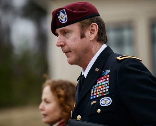 FILE - In this March 4, 2014, file photo, Brig. Gen. Jeffrey Sinclair leaves the courthouse following a day of motions at Fort Bragg, N.C. A news release Sunday, March 16, 2014, from lawyers representing Sinclair said that he will plead to lesser charges in exchange for having the sexual assault charges dropped along with two others that might have required Sinclair to register as a sex offender. Sinclair was accused of twice forcing a female captain to perform oral sex on him during a three-year extramarital affair. (AP Photo/The Fayetteville Observer, James Robinson, File)