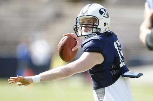 Chris Detrick      Tribune file photo Brigham Young Cougars quarterback Ammon Olsen (15) during the spring scrimmage at LaVell Edwards Stadium Saturday March 30, 2013.