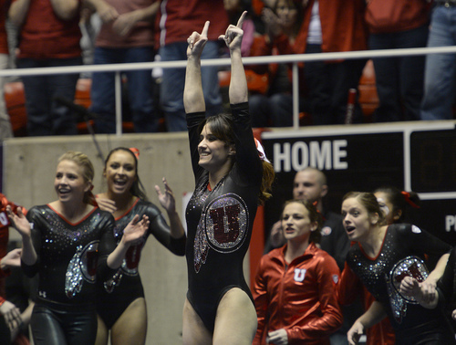 Rick Egan  | The Salt Lake Tribune   Nansy Damianova salutes the crowd after her performance on the floor, just seconds before her score of a perfect 10 was announced to the crowd, in PAC 12 gymnastics action, Utah vs. Georgia, Saturday, March 15, 2014.