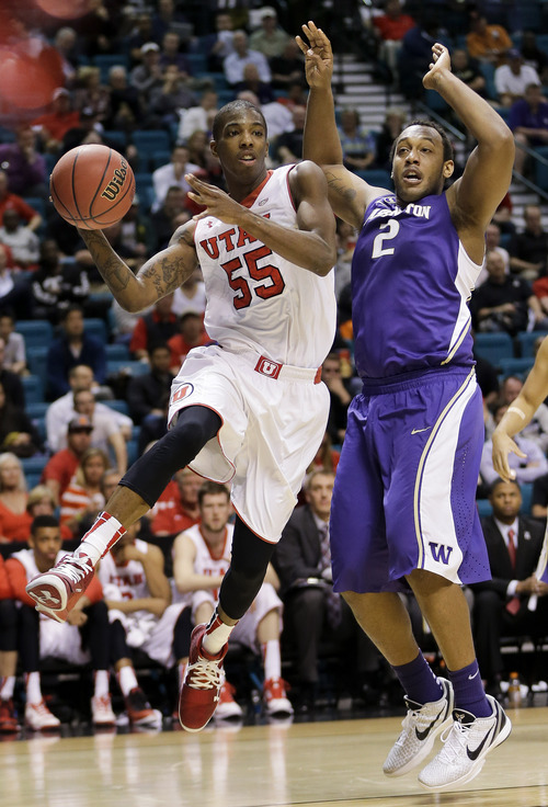 Utah's Delon Wright (55) passes the ball off against Washington's Perris Blackwell in the second half of an NCAA Pac 12 conference tournament college basketball game, Wednesday, March 12, 2014, in Las Vegas. Utah won 67-61. (AP Photo/Julie Jacobson)