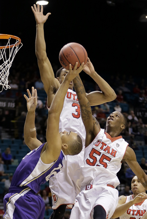 Utah's Delon Wright (55) blocks a shot by Washington's Andrew Andrews as Utah's Princeton Onwas (3) helps defend in the first half of an NCAA Pac 12 conference tournament college basketball game, Wednesday, March 12, 2014, in Las Vegas. (AP Photo/Julie Jacobson)