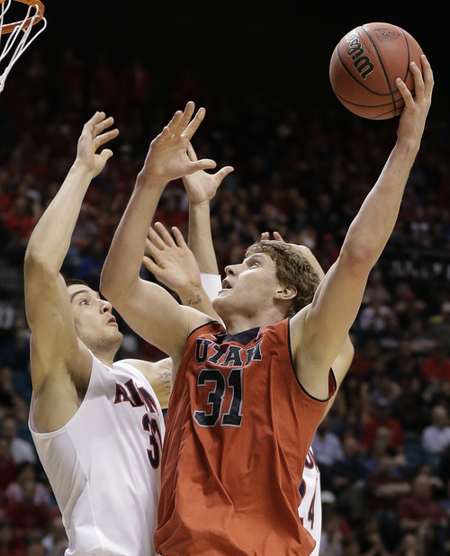Utah's Dallin Bachynski (31) puts up a shot against Arizona's Matt Korcheck in the second half of an NCAA Pac-12 conference tournament college basketball game, Thursday, March 13, 2014, in Las Vegas. Arizona won 71-39. (AP Photo/Julie Jacobson)