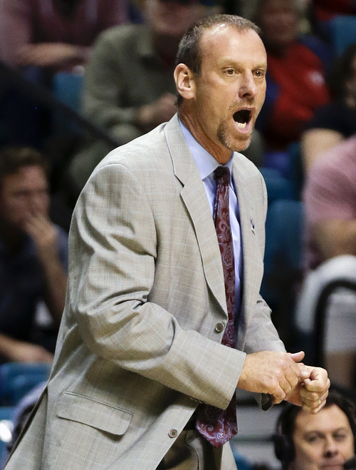 Utah coach Larry Krystkowiak shouts to players in the second half of an NCAA Pac 12 conference tournament college basketball game against Washington, Wednesday, March 12, 2014, in Las Vegas. Utah won 67-61. (AP Photo/Julie Jacobson)