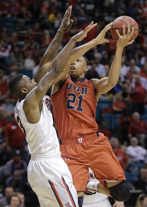 Utah's Jordan Loveridge (21) puts up a shot against Arizona's Rondae Hollis-Jefferson in the second half of an NCAA Pac-12 conference tournament college basketball game, Thursday, March 13, 2014, in Las Vegas. Arizona won 71-39. (AP Photo/Julie Jacobson)