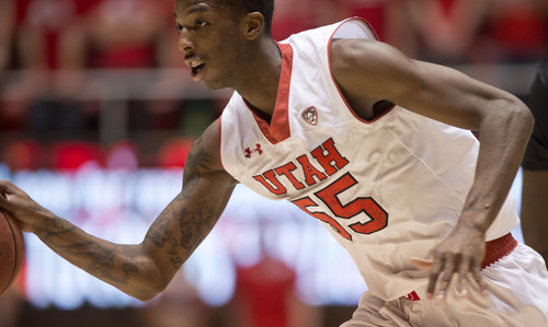 Lennie Mahler     The Salt Lake Tribune Utah's Delon Wright brings the ball up the court in the second half against Colorado at the Huntsman Center, Saturday, March 1, 2014.