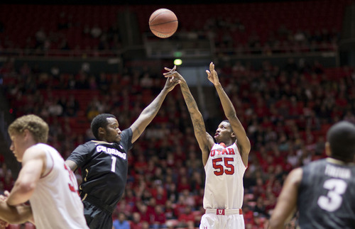 Lennie Mahler     The Salt Lake Tribune Utah's Delon Wright shoots over Colorado's Wesley Gordon in the first half of a game at the Huntsman Center, Saturday, March 1, 2014.