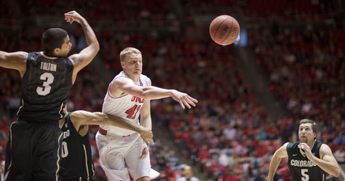 Lennie Mahler     The Salt Lake Tribune Utah's Jeremy Olsen swats at a rebound as Colorado's Xavier Talton and Eli Stalzer rush to gain possession in the first half of a game at the Huntsman Center, Saturday, March 1, 2014.