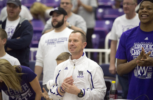 Steve Griffin  |  The Salt Lake Tribune   Weber State Wildcats men's basketball Randy Rahe smiles as his team celebrates their selection into the 2014 NCAA Basketball Tournament during selection party at the Dee Events Center in Ogden, Utah Sunday, March 16, 2014. Weber State will meet the number one seed Arizona Wildcats.