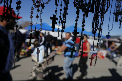 Keith Johnson | The Salt Lake Tribune Shoppers will often come across, well, crosses at swap meets. Here, rosaries hang from a vendor's tent in West Valley City on March 31, 2013.