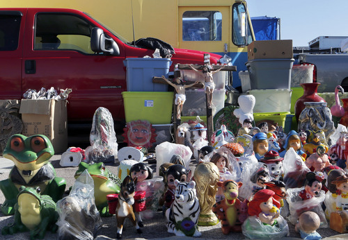 Keith Johnson | The Salt Lake Tribune The sacred mixes with the mundane, even the tacky, at this West Valley City swap meet March 31, 2013, as large crucifixes rest alongside bins of toys and  other ceramic figurines.