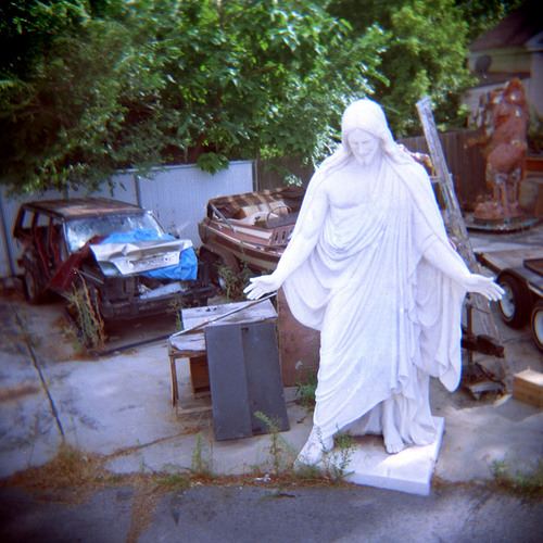 Keith Johnson | The Salt Lake Tribune Finding a 9-foot statue of the Christus at Mormon Art & Bronze in Provo in 2006 isn't surprising. But finding it out back with vehicles and other goods is.