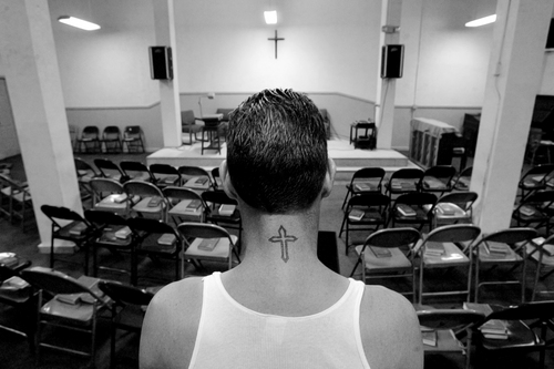 Keith Johnson | The Salt Lake Tribune Steve Fredricks may not wear his religion on his sleeve, but he does wear it on his neck. Here, he worships at a Jesus Saves shelter in Salt Lake City on June 29, 2007.