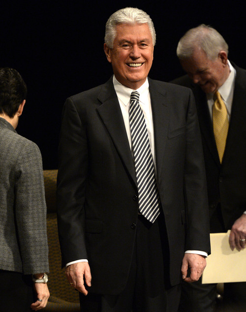 "Rick Egan | The Salt Lake Tribune  President Dieter F. Uchtdorf, second counselor in the LDS Church's governing First Presidency, acknowledges the crowd, before giving the keynote address to the ""Church History Symposium."" at the LDS Conference Center Theater, Friday, March 7, 2014"