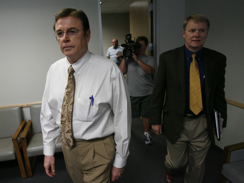 Val Southwick, left, accompanied by his attorneys arrives at the Ken Garff building in Salt Lake on Wednesday after being ordered by the federal bankruptcy court to attend a meeting of creditors of his VesCor Capital Corp. The judge has declared that his company engaged in fraud in what could prove to be one of the largest fraud cases in Utah history. Photo by Francisco Kjolseth/The Salt Lake Tribune 9/12/2007