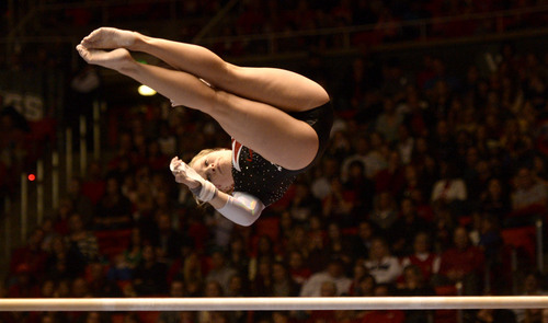 Rick Egan  | The Salt Lake Tribune   Tory Wilson competes on the bars for the Utes, in their Gymnastics opener, Utah vs, BYU, Boise State and Southern Utah University,  at the Huntsman Center, Friday, January 10, 2014.