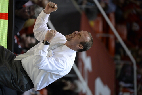 Francisco Kjolseth  |  The Salt Lake Tribune Utah coach Larry Krystkowiak cheers on his team against Washington in game action at the Huntsman Center on the University of Utah campus on Thursday, Feb. 6, 2014.