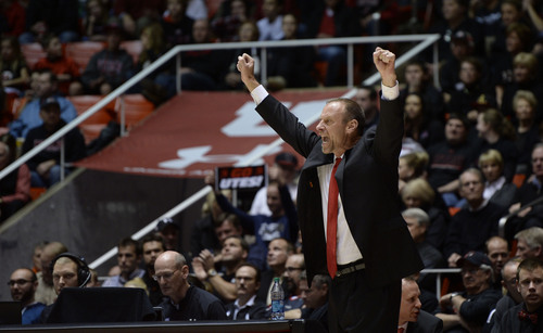 Francisco Kjolseth  |  The Salt Lake Tribune Utah coach Larry Krystkowiak gets into the game against USC at the Huntsman Center on the University of Utah campus on Thursday, Jan. 16, 2014.