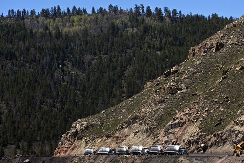 Chris Detrick |   Tribune file photo  Trucks line up to receive coal at Sufco Mine, which is seeking to tap the Greens Hollow tract on adjacent Forest Service land in Sevier County. The mine, Utah's longest operating and most prolific, needs to lease this tract, which would yield 57 million tons, to keep operating and feeding Emery County power plants.