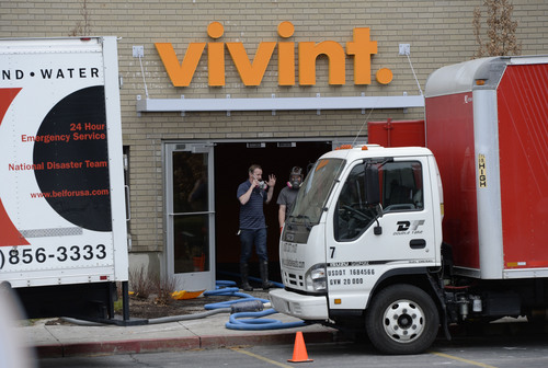 Franciso Kjolseth  |  The Salt Lake Tribune Crews begin clean up at the Vivint building in Lindon on Tuesday, Feb. 18, 2014, following a fire that broke out earlier in the day. Hundreds of workers in the building, which serves as a call center for the home automation, security and energy management company were evacuated.