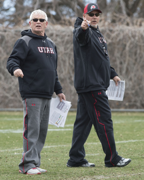 Steve Griffin  |  The Salt Lake Tribune   New University of Utah offensive coordinator, Dave Christensen, right, and running backs coach, Dennis Erickson, work with players during spring football practice on the University of Utah campus in Salt Lake City, Utah Tuesday, March 18, 2014.