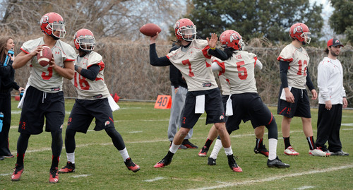 Steve Griffin  |  The Salt Lake Tribune  The University of Utah quarterbacks, lead by Travis Wilson, #7, center, throw downfield during spring practice on the University of Utah campus in Salt Lake City, Utah Tuesday, March 18, 2014.