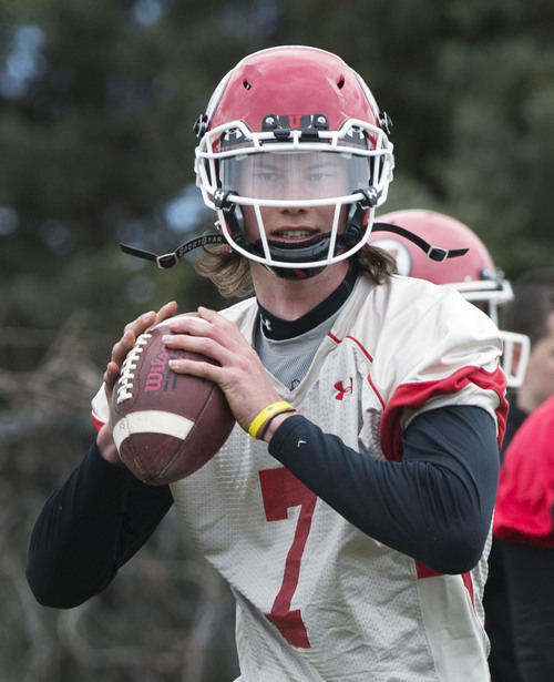 Steve Griffin  |  The Salt Lake Tribune  University of Utah quarterback Travis Wilson runs plays during spring practice on the University of Utah campus in Salt Lake City, Utah Tuesday, March 18, 2014.