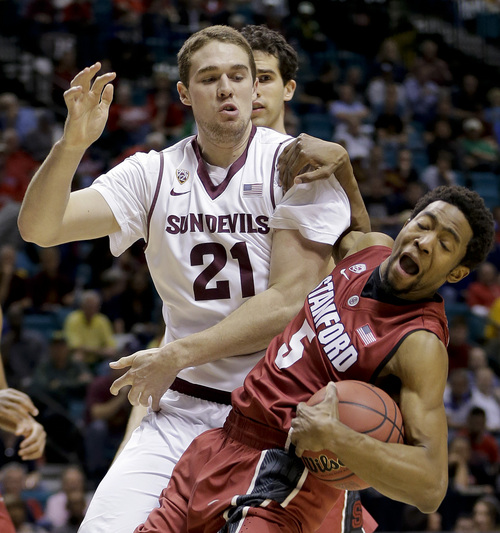 Stanford's Chasson Randle (5) pulls down a rebound against Arizona State's Eric Jacobsen (21) in the first half of an NCAA college basketball game in the Pac-12 men's tournament quarterfinals, Thursday, March 13, 2014, in Las Vegas. (AP Photo/Julie Jacobson)