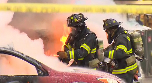 In this image made from video provided by KOMO-TV, emergency crews respond to the scene of a news helicopter crash outside the KOMO-TV studios near the space needle in Seattle, Tuesday, March 18, 2014, in Seattle. The station says the copter was apparently lifting off Tuesday morning when it possibly hit the side of the building and went down, hitting several vehicles. (AP Photo/Courtesy KOMO-TV) MANDATORY CREDIT