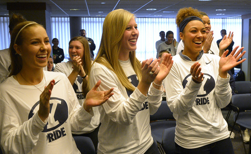 Rick Egan  | The Salt Lake Tribune   L-R BYU women's basketball players, Makenzi Morrison, Ashley Garfield, Xojian Harry, cheer as BYU is selected for the NCAA tournament, during a get together at the Marriott Center. Monday, March 17, 2014.  BYU will meet North Carolina State in the first round.