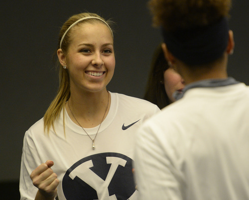 Rick Egan  | The Salt Lake Tribune   L-R BYU women's basketball player, Makenzi Morrison celebrates after BYU found out that they will meet North Carolina State in the first round of the NCAA basketball tournament, during a get together at the Marriott Center. Monday, March 17, 2014.