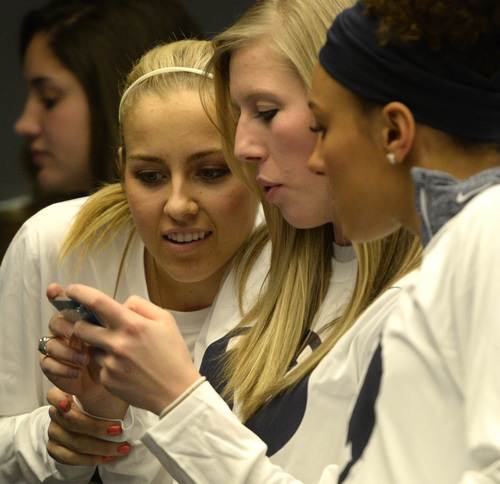 Rick Egan  | The Salt Lake Tribune   L-R BYU women's basketball players,Makenzi Morrison, Ashley Garfield, Xojian Harry, check out the match-ups for the NCAA tournament after  they found out that they will meet North Carolina State in the first round, during a get together at the Marriott Center. Monday, March 17, 2014.