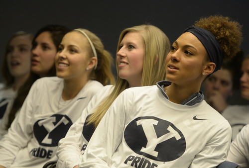Rick Egan  | The Salt Lake Tribune   L-R BYU women's basketball players,  Makenzi Morrison, Ashley Garfield, Xojian Harry, watch to see if BYU will be  selected for the NCAA tournament, at the Marriott Center. Monday, March 17, 2014.  BYU will meet North Carolina State in the first round.