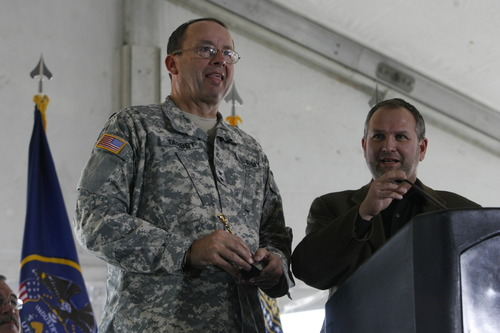 Trent Nelson | The Salt Lake Tribune Then-Utah National Guard Gen. Brian Tarbet (left) speaks with Harvey Davis, director for installations and logistics at the National Security Agency, during the groundbreaking ceremony for the Utah Data Center on Jan. 6, 2011.