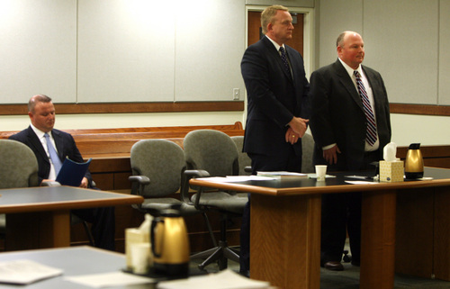 Geoff Liesik | Pool Photo Glenn Taylor, far right, stands with defense attorney Scott Card during a court hearing Tuesday, March 18, 2014, for Taylor and his co-defendant, David Hall, seated at left. Hall and Taylor admitted that they toppled a prehistoric rock formation, known as a hoodoo, during an October 2013 visit to Goblin Valley State Park. Taylor pleaded guilty to attempted criminal mischief, a class A misdemeanor, and Hall pleaded guilty to attempting to aid or abet criminal mischief, also a class A misdemeanor.