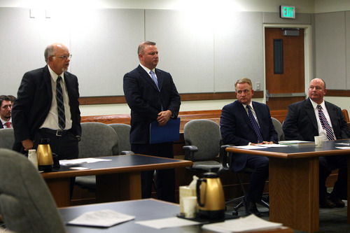 Geoff Liesik | Pool Photo Emery County prosecutor Brent Langston, far left, speaks during a court hearing Tuesday, March 18, 2014, for David Hall, standing, and Glenn Taylor, seated far right. Hall and Taylor admitted that they toppled a prehistoric rock formation, known as a hoodoo, during an October 2013 visit to Goblin Valley State Park. Taylor pleaded guilty to attempted criminal mischief, a class A misdemeanor, and Hall pleaded guilty to attempting to aid or abet criminal mischief, also a class A misdemeanor.
