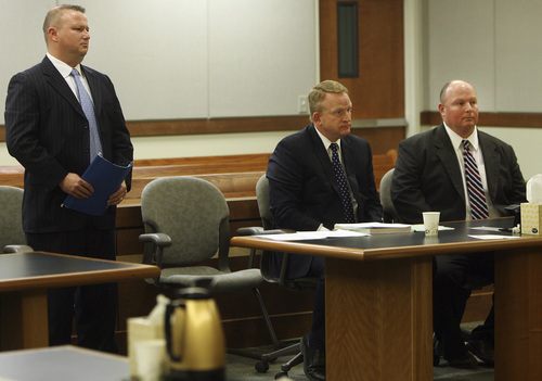 David Hall, standing, enters his guilty plea during a court hearing Tuesday, March 18, 2014, for Hall and his co-defendant, Glenn Taylor, seated far right. Hall and Taylor admitted that they toppled a prehistoric rock formation, known as a hoodoo, during an October 2013 visit to Goblin Valley State Park. Taylor pleaded guilty to attempted criminal mischief, a class A misdemeanor, and Hall pleaded guilty to attempting to aid or abet criminal mischief, also a class A misdemeanor.
