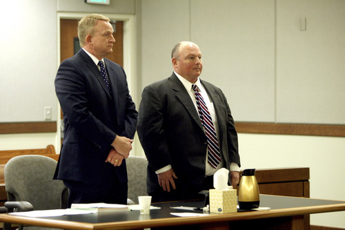 Geoff Liesik | Pool Photo Glenn Taylor, right, stands with his defense attorney, Scott Card, during a court hearing Tuesday, March 18, 2014, for Taylor and his co-defendant, David Hall, seated at left. Hall and Taylor admitted that they toppled a prehistoric rock formation, known as a hoodoo, during an October 2013 visit to Goblin Valley State Park. Taylor pleaded guilty to attempted criminal mischief, a class A misdemeanor, and Hall pleaded guilty to attempting to aid or abet criminal mischief, also a class A misdemeanor.
