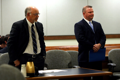 Geoff Liesik | Pool Photo Emery County prosecutor Brent Langston, left, speaks during a court hearing Tuesday, March 18, 2014, for David Hall, right. Hall and his co-defendant Glenn Taylor admitted that they toppled a prehistoric rock formation, known as a hoodoo, during an October 2013 visit to Goblin Valley State Park. Taylor pleaded guilty to attempted criminal mischief, a class A misdemeanor, and Hall pleaded guilty to attempting to aid or abet criminal mischief, also a class A misdemeanor.