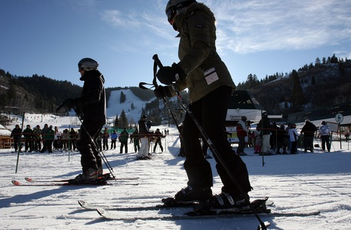 Steve Griffin  |  The Salt Lake Tribune Skiers enjoy the sunshine at Deer Valley Resort in Park City in 2011. Ski Utah, Deer Valley and Snowbird are considering the possibility of chairlifts that would link the two resorts.