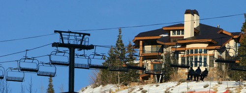 Steve Griffin  |  The Salt Lake Tribune   Skiers ride a ski lift that passes in front of a large home at Deer Valley Resort in Park City, Utah Tuesday, December 20, 2011. Ski Utah, Deer Valley and Snowbird are considering the possibility of chairlifts that would link the two resorts.