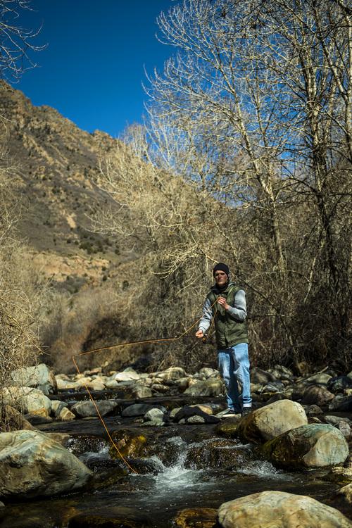 Chris Detrick     The Salt Lake Tribune Brian Cleveland, of Salt Lake City, fishes in Big Cottonwood Creek Thursday March 20, 2014.
