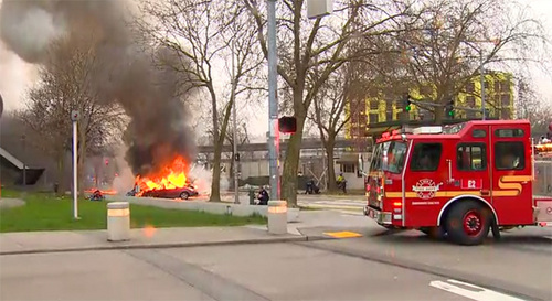 In this image made from video provided by KOMO-TV, smoke rises from the scene of a news helicopter crash outside the KOMO-TV studios near the space needle in Seattle, Tuesday, March 18, 2014, in Seattle. The chopper was taking off from a helipad on KOMO-TV's roof when it went down at a busy downtown intersection and hit three vehicles, starting them on fire and spewing burning fuel down the street. Two people on board the helicopter died. (AP Photo/Courtesy KOMO-TV) MANDATORY CREDIT