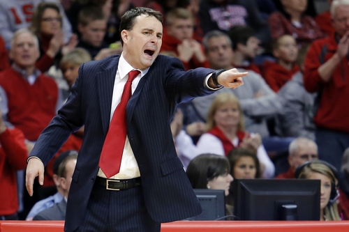 FILE - In this Dec. 7, 2013, file photo, Dayton coach Archie Miller calls out from the bench during an NCAA college basketball game against Illinois State in Normal, Ill. John Miller's sons _ Sean, who coaches No. 1 West seed Arizona; and younger brother Archie, who coaches No. 11 South seed Dayton _ could meet in the Final Four. (AP Photo/ Stephen Haas, File)