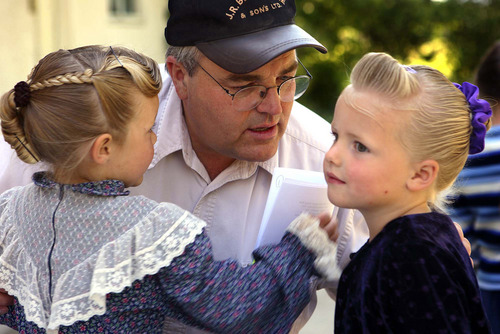 The Children of Polygamy. Children of polygamist Winston Blackmore, playing the rural setting  Polygamist Winston Blackmore hugs his daughters Malla, left, and Marissa on the family farm in Lister, British Columbia, Canada.