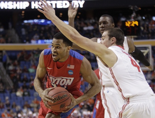 Dayton's Vee Sanford (43) drives past Ohio State's Aaron Craft (4) during the first half of a second-round game in the NCAA college basketball tournament Thursday, March 20, 2014, in Buffalo, N.Y.  (AP Photo/Bill Wippert)