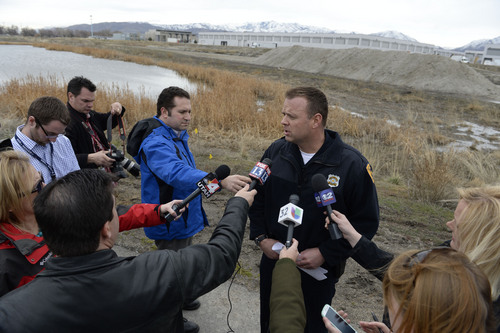 Francisco Kjolseth  |  The Salt Lake Tribune Salt Lake City police detective Cody Lougy speaks with members of the media alongside the Jordan River as they act on credible new tips in the disappearance of Aletha Jo Williams who went missing in 2002.