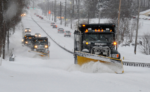 FILE - In this Feb. 13, 2014 file photo a line of trucks with plows head south on Route 202 between Dilworthtown Road and Route 1 in Birmingham Township, Pa. As spring officially begins Thursday, officials across much of the nation are still paying the bills for keeping roads clear during the cold, snowy winter. In Pennsylvania, legislators have approved special appropriations that will help but won't pay for everything. (AP Photo/Philadelphia Inquirer, Clem Murray, File)