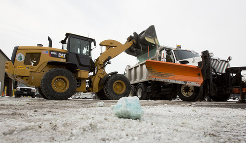 FILE - In this Feb. 4, 2014 file photo salt to be spread on roads is loaded into a truck in Glen Ellyn, Ill. As spring officially begins Thursday, officials across much of the nation are still paying the bills for keeping roads clear during the cold, snowy winter. Illinois is 200 percent over its three-year average, and its crews have spread almost double the usual volume of salt. (AP Photo/Andrew A. Nelles, File)