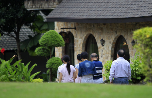 Chinese relatives of passengers aboard a missing Malaysia Airlines plane, walk back to their rooms at a resort in Cyberjaya, Malaysia, Thursday, March 20, 2014. Flight 370 disappeared March 8 on a night flight from Kuala Lumpur to Beijing. Malaysian authorities have not ruled out any possible explanation, but have said the evidence so far suggests the flight was deliberately turned back across Malaysia to the Strait of Malacca, with its communications systems disabled. (AP Photo/Lai Seng Sin)
