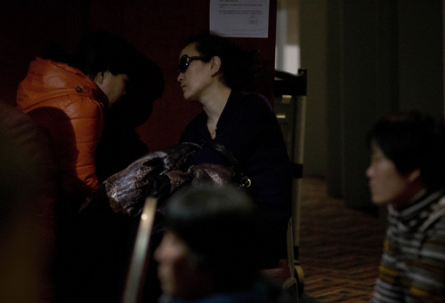 Relatives of Chinese passengers aboard the missing Malaysia Airlines, MH370 wait for news about the plane at a hotel ballroom in Beijing, China, Thursday, March 20, 2014. Four military search planes were dispatched Thursday to try to determine whether two large objects bobbing in a remote part of the Indian Ocean spotted by satellite imagery were part of a possible debris field of the missing Malaysia Airlines flight. (AP Photo/Andy Wong)
